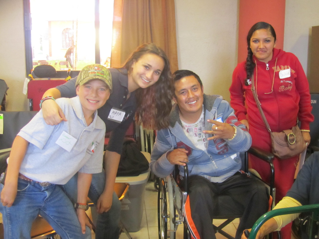 Everyone smiles when the wheelchairs are donated